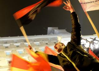 Supporters of the VMRO-DPMNE celebrate after preliminary results in Skopje. 11 December 2016
