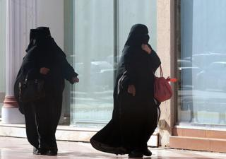 Photo shows two Muslim women in full veil out shopping.