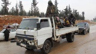 Syrians being evacuated from Aleppo drive through rebel-held territory near Rashidin (22 December 2016)