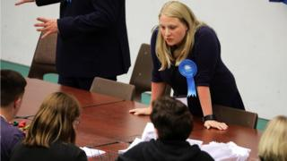 A Conservative party worker keeps a close eye on the recount of votes in Hastings