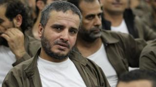 Ahmed Daqamseh (centre) in a Jordanian prison. Photo: August 2012