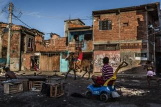 Boys riding on their work horse at Favela Vila do Metrô community, Mangueira, Rio de Janeiro, Brazil.