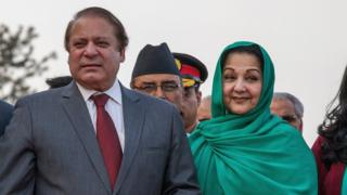Prime Minister of Pakistan Nawaz Sharif poses with his wife Kalsoom Nawaz Sharif upon his arrival for the 18th SAARC Summit on November 25, 2014 in Kathmandu, Nepal