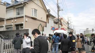 Members of the media gather in front of an apartment building where media reported nine bodies were found in Zama, Kanagawa Prefecture, Japan in this photo taken by Kyodo on October 31, 2017