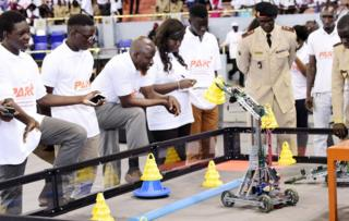 A robot performs during the final of the national robotics competition on May 20, 2017 at the Marius Ndaye stadium in the Senegalese capital Dakar.