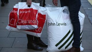 Shoppers with John Lewis bags