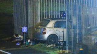 A car crashed into a fence