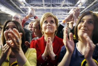 SNP leader Nicola Sturgeon reacting as results came in at a Scottish Parliament election by praying