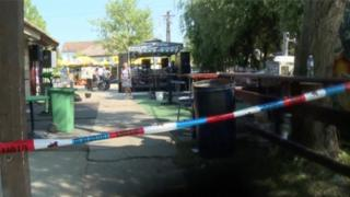A police tape is seen in a cordoned area at a cafe after a shooting during a local festival in the village of Zitiste, north of Belgrade, Serbia in this still image from video taken 2 July2016.