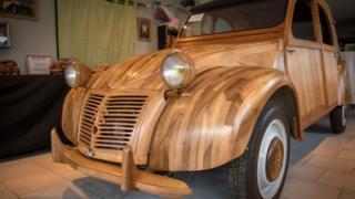 A Citroen 2 CV made out of fruitwood