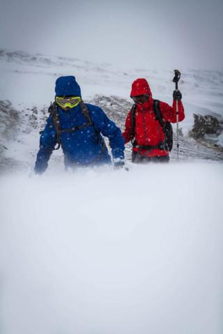 Walkers in snow in Southern Cairngorms
