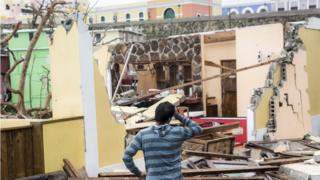 Image shows damaged homes after Hurricane Maria made landfall on 21 September 2017 in San Juan, Puerto Rico