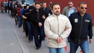 member of Turkish police escort Gulen members