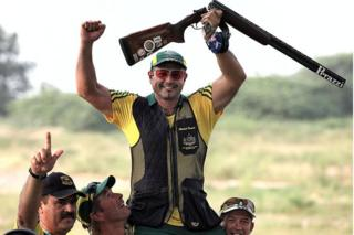 Australian shooter Michael Diamond celebrates after winning gold at the 2010 Commonwealth Games in Delhi, India