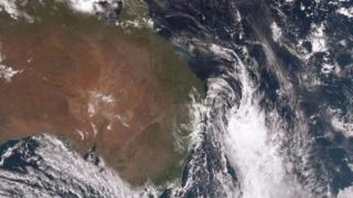 A satellite image showing the storm system moving out to sea.