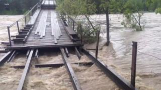 The Altai bridge damaged by floods