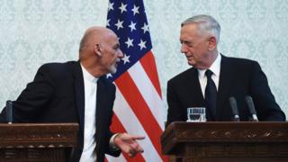 US Defense Secretary Jim Mattis (R) speaks with Afghan President Ashraf Ghani during a press conference at the Presidential Palace in Kabul on September 27, 2017