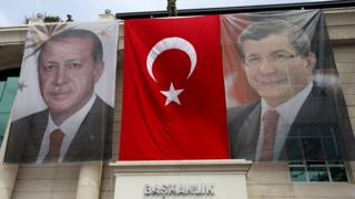 Portraits of Turkey's President Tayyip Erdogan (L), Prime Minister Ahmet Davutoglu (file pic June 2015)