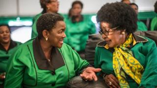 Africa National Congress stalwart Winnie Madikizela Mandela (R) listens to ANC Women League President Bathabile Dlamini