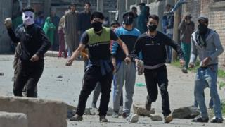 Kashmiri protestors clash with Indian security forces near a polling station in Srinagar on April 9, 2017