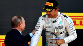Nico Rosberg of Germany and Mercedes GP collects his winners trophy from Russian President Vladimir Putin during the Formula One Grand Prix of Russia at Sochi Autodrom on May 1, 2016