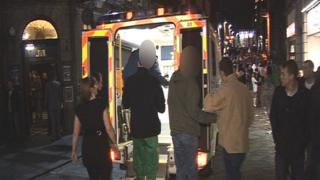 Patient being helped onto ambulance