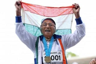 101-year-old Man Kaur from India celebrates after competing in the 100m sprint in the 100+ age category at the World Masters Games at Trusts Arena in Auckland on April 24, 2017.