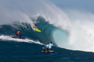 Hawaiian surfer Paige Alms surfs a big wave at Jaws, off the coast of the Maui Island in Hawaii to win the Peahi Challenge 2016, on November 11, 2016, the first-ever Women's Big Wave Tour event.