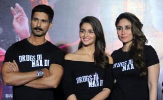 Indian Bollywood actor Shahid Kapoor(L)poses with actresses Alia Bhatt(C)and Kareena Kapoor Khan(R)during the trailer launch of the forthcoming Hindi film Udta Punjab written and directed by Abhishek Chaubey in Mumbai on April 17, 2016.
