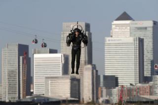 David Mayman piloting the JB-10 Jetpack flying machine over the Royal Victoria Docks in east London