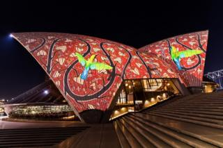An Indigenous light display projected on to the Sydney Opera House