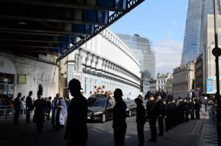 Police officers line the streets as the funeral cortege of PC Keith Palmer leaves Southwark Cathedral