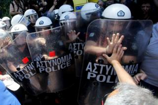 Greek striking medical personnel scuffle with riot police during a protest in central Athens, Greece