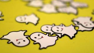 The logo of messaging app Snapchat is seen at a booth at TechFair LA, a technology job fair, in Los Angeles, California,
