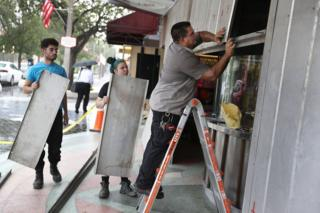 People put up shutters as they prepare the Actors' Playhouse at the Miracle Theatre for Hurricane Irma in Miami, Florida, 6 September