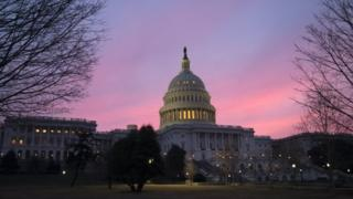 The US Capitol dome at sunrise.