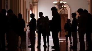 Reporters wait for the arrival of senators for vote on the tax bill on Capitol Hill in Washington, DC on December 1, 2017