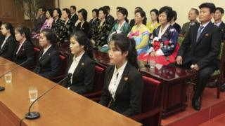 Colleagues and family members of 12 North Korean waitresses are presented to the media in Pyongyang, North Korea, Tuesday, May 3, 2016.