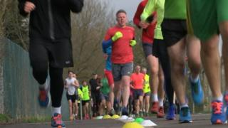 Runners in Little Stoke Park near Bristol taking part in a parkrun UK event