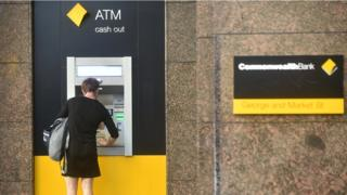 A woman using a Commonwealth Bank ATM