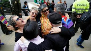 LGBT rights activist celebrate a Constitutional Court decision to give gay couples marriage rights, outside the Justice Palace in Bogota, Colombia.