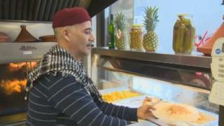 Chef Abdelkader Bejaoui dishes up a hot meal at Marche Ferdous