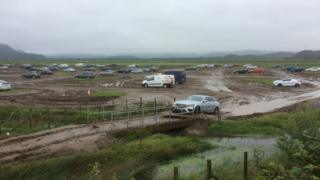 The remaining cars at the Festival No.6 park and ride after flooding