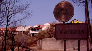Varzeas - fire-blackened road sign