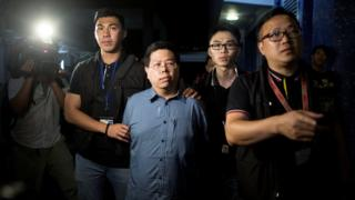"""Police arrest Democratic Party member Howard Lam (C) for """"misleading police"""" after he claimed he had been assaulted and illegally detained by mainland Chinese agents, in Hong Kong, China, China 15 August 2017"""