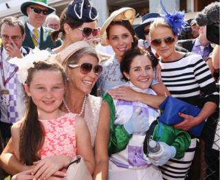 Michelle Payne celebrates with her sisters at the Melbourne Cup (3 Nov 2015)