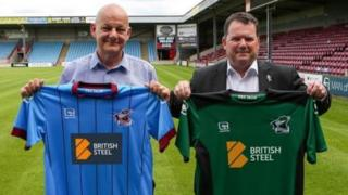 Paul McBean and Peter Swann with the new Scunthorpe United football kit