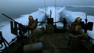 US military personnel on a riverine patrol boat