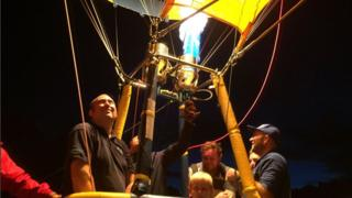 Pilot in balloon operates burner