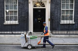 A street sweeper cleans the street outside 10 Downing Street